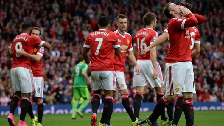 Le bonheur de Wayne Rooney, buteur, et de tout Manchester United (OLI SCARFF / AFP)