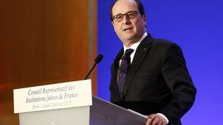 Le président de la République François Hollande prononce un discours au 30e dîner annuel du Conseil représentatif des institutions juives de France, le 23 février 2015 à Paris. (ETIENNE LAURENT / POOL)