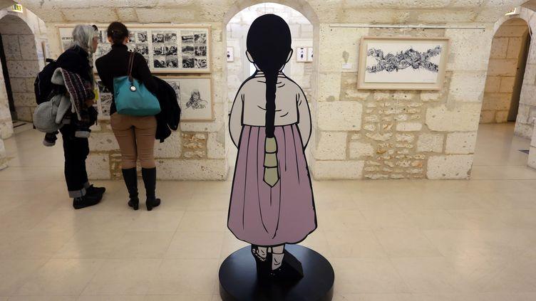 """L'exposition """"Les femmes de réconfort"""" au festival d'Angoulême (Charente), le 30 janvier 2014. (NICOLAS TUCAT / AFP)"""