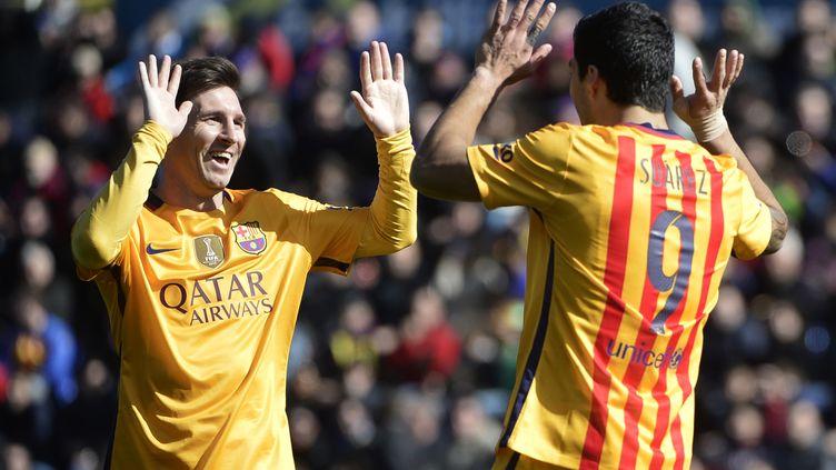 Messi et Suarez (Barcelone) se sont bien amusés (JOSE JORDAN / AFP)