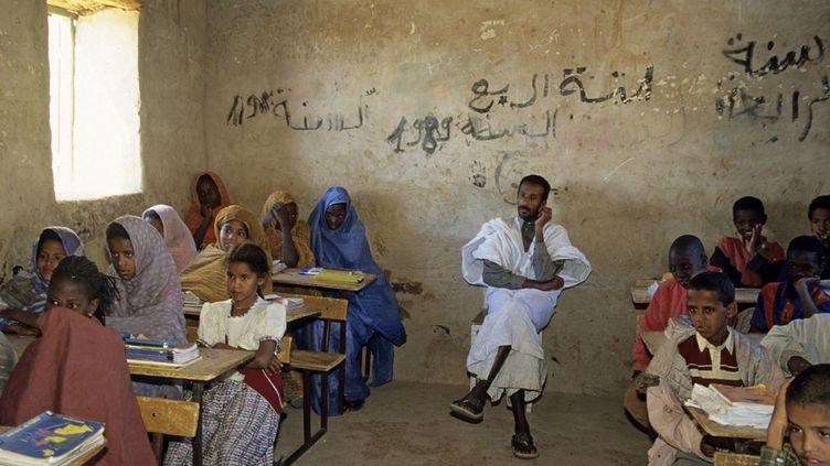 Il est loin le temps où Ouadane, la «cité des deux oueds» fondée au XIIe siècle, était présentée comme le lieu du savoir et de la culture qui attirait les érudits de l'islam. Aujourd'hui, malgré les efforts du gouvernement mauritanien pour venir en aide aux villes anciennes, la situation reste préoccupante. (Jacques SERPIENSKY / Aurimages)