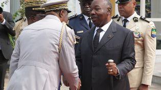 Le président gabonais Ali Bongo lors d'une cérémonie à Libreville, en août 2019. (STEEVE JORDAN / AFP)