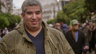 Le journaliste Akram Kharief lors d'une marche à Alger, en 2019. (Akram Kharief)