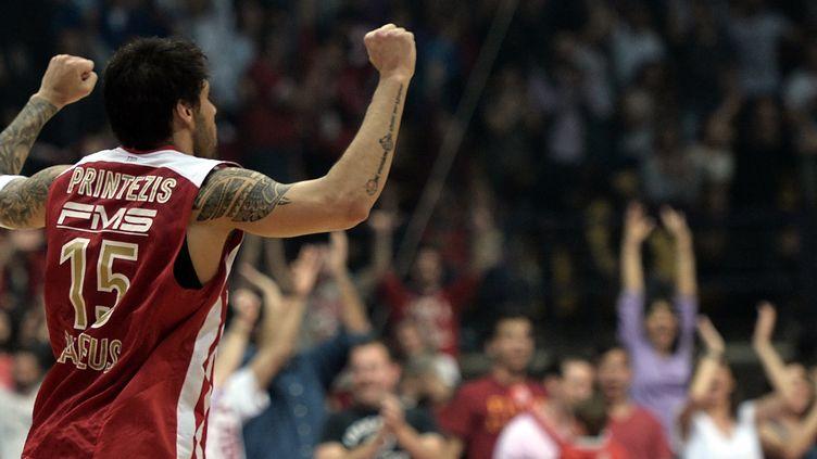 Giorgos Printezis exulte : l'Olympiakos est encore en vie (LOUISA GOULIAMAKI / AFP)