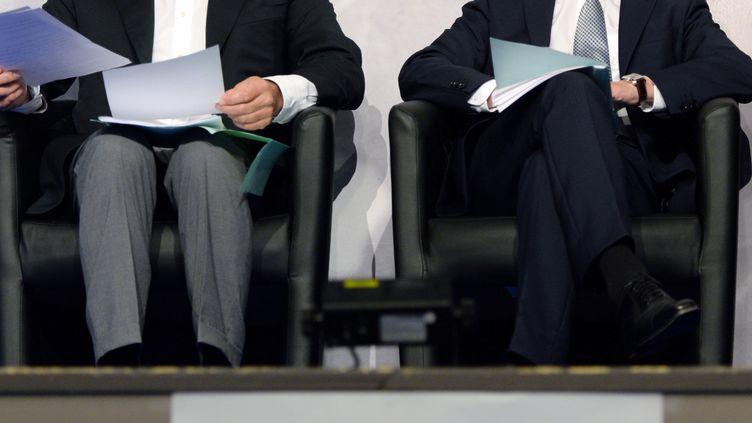 Le président du Parti radical de gauche, Jean-Michel Baylet, et le Premier ministre, Manuel Valls, lors du congrès du PRG à Seignosse (Landes), le 15 septembre 2013. (JEAN-PIERRE MULLER / AFP)