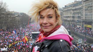 Frigide Barjot, porte-parole de La Manif pour tous, collectif opposé au mariage des couples de même sexe, lors d'une manifestation, à Paris,le 24 mars 2013. (PIERRE ANDRIEU / AFP)