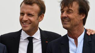 Emmanuel Macron et le ministre de la Transition écologique et solidaire, Nicolas Hulot, le 20 juin 2018, à Plevenon (Côtes-d'Armor). (FRED TANNEAU / AFP)