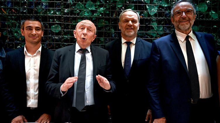 Yann Cucherat, Gérard Collomb,Francois-Noël Buffet et Etienne Blanc (de gauche à droite), lors de la conférence de presse annonçant leur alliance, le 28 mai 2020, à Lyon. (JEFF PACHOUD / AFP)