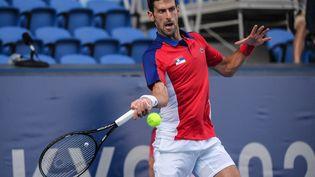 Novak Djokovic s'est incliné contre Pablo Carreno Busta, le 31 juillet 2021 à Tokyo. (TIZIANA FABI / AFP)