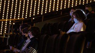 Les premiers clients assistent a la réouverture du cinema UGC Les Halles, le 19 mai 2021. (AURELIEN MORISSARD / MAXPPP)