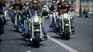 Johnny Hallyday au guidon d'une Harley Davidson, en mai 1990. (MAXPPP)