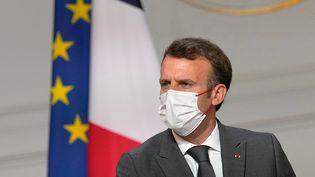 Le président de la République, Emmanuel Macron, lors d'une rencontre avecles acteurs de la filière automobileà l'Elysée, le 12 juillet 2021. (MICHEL EULER / AFP)