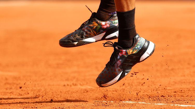 Jo-Wielfried Tsonga, en action lors des Internationaux de Roland-Garros, le 24 mai 2015. (ELLA LING / BACKPAGE IMAGES LTD)