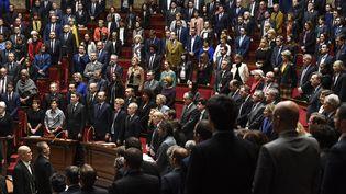 Les députés observent une minute de silence à l'Assemblée nationale, le 12 décembre 2018. (BERTRAND GUAY / AFP)