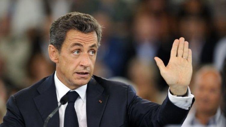 Nicolas Sarkozy au Cap d'Agde le 26 juillet 2011 (AFP - ERIC FEFERBERG)