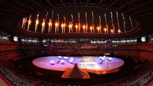 L'intérieur du Stade olympique national et ses 68 000 places vides. Seulsquelques centainesde responsables politiques étaient présents, dont l'empereur du Japon Naruhito, le président français Emmanuel Macronou encorela première dame des États-Unis Jill Biden.Une entrée en matière dans uneatmosphère particulière quelques minutes avant le défilé des 206 délégations présentes pour ces Jeux olympiques. (KAZUKI WAKASUGI / YOMIURI / AFP)