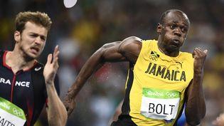 Christophe Lemaitre et Usain Bolt, le 18 août 2016 aux Jeux olympiques de Rio. (MARTIN BUREAU / AFP)