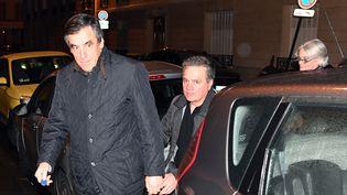 François et Penelope Fillon arrivent à leur domicile, à Paris, après leur audition par la police, le 30 janvier 2017. (ALAIN JOCARD / AFP)