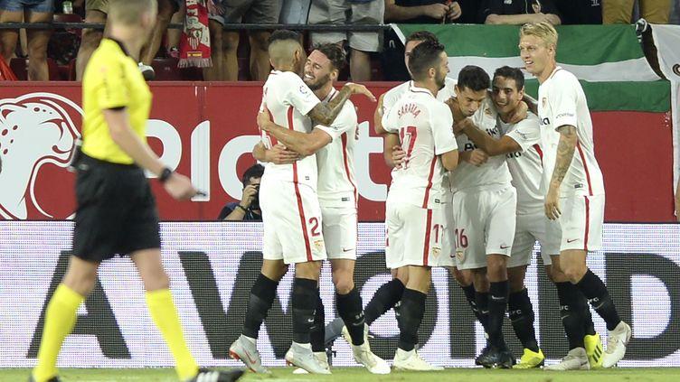 La joie des joueurs du FC Séville (CRISTINA QUICLER / AFP)