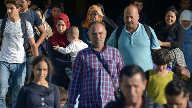 Réfugiés syriens au port d'Athènes en août 2015. (AFP / Christos Stamos)