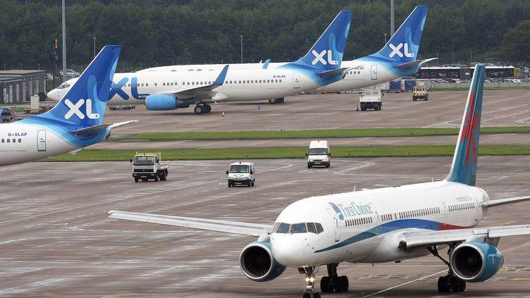 Des avions de la compagnie XL Airways, le 12 septembre 2008 à Manchester. (PAUL ELLIS / AFP)