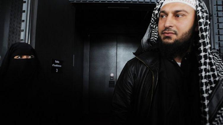 Lies Hebbadj et sa compagne (28 juin 2010) (AFP/FRANK PERRY)