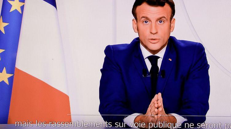 Le président Emmanuel Macron s'adresse aux Français sur l'allègement du second confinement dans le cadre de l'épidémie de Covid-19, depuis l'Elysée, à Paris, le 24 novembre 2020. (THOMAS COEX / AFP)