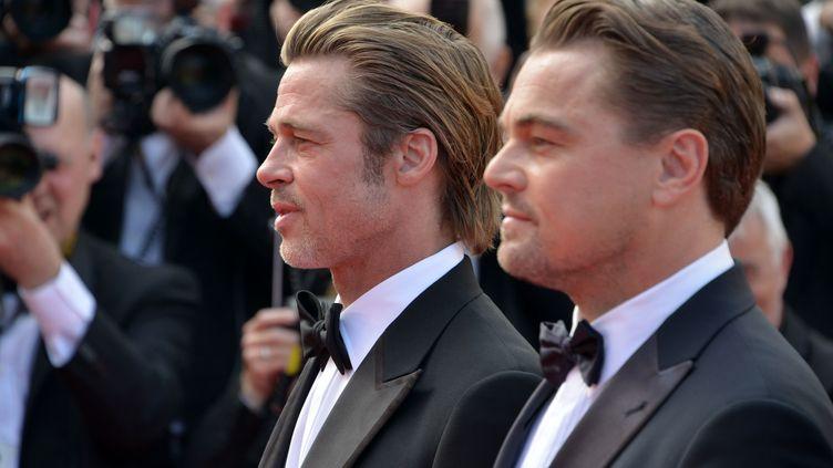 Brad Pitt etLeonardo Di Caprio au Festival de Cannes (Alpes-Maritimes), le 28 mai 2019. (JACKY GODARD / AFP)