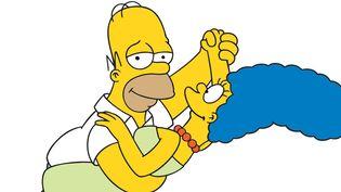 Homer et Marge Simpson dans une présentation des personnages en 1989.  (Archives du 7eme Art / Photo12)