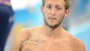 Amaury Leveaux participe à un entraînement, le 25 juillet 2012, au centre aquatique de Londres (Royaume-Uni). (MARTIN BUREAU / AFP)