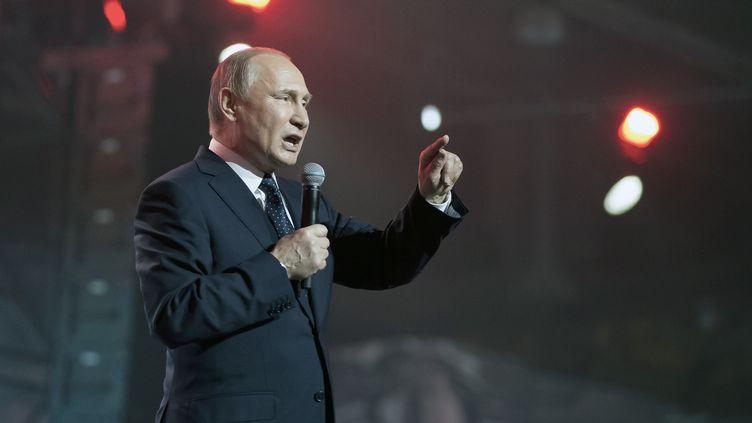 Vladimir Poutine, en meeting, le 15 mars 2018. (ALEXANDER ZEMLIANICHENKO / POOL)