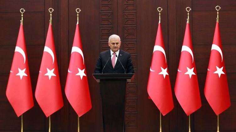 Le Premier ministre turc,Binali Yildirim, lors d'une conférence de presse sur l'accord passé avec Israël, le 27 juin 2016, à Ankara (Turquie). (ADEM ALTAN / AFP)