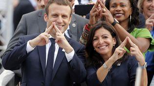 Emmanuel Macron et Anne Hidalgo défendent la candidature de Paris pour l'organisation des JO 2024. (JEAN-PAUL PELISSIER / POOL)