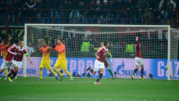 Kevin Prince Boateng célèbre le but qu'il vient d'inscrire pour le Milan AC devant Barcelone (OLIVIER MORIN / AFP)