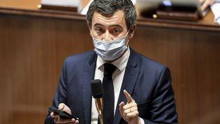 """Le ministre de l'Intérieur, Gérald Darmanin, lors des débats sur l'examen de la proposition de loi """"sécurité globale"""", à l'Assemblée nationale, le 20 novembre 2020. (BERTRAND GUAY / AFP)"""