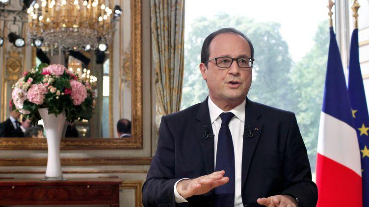 Le président de la République, François Hollande, lors de la traditionnelle interview du 14-Juillet, le lundi 14 juillet 2014, à l'Elysée. (THIBAULT CAMUS / AFP)