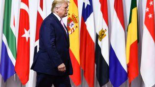 Le président américain Donald Trump, le 28 juin 2019, lors de son arrivée au Sommet du G20, à Osaka (Japon). (BRENDAN SMIALOWSKI / AFP)