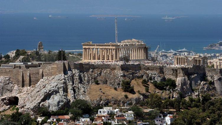 Pour les cinéastes, filmer sur la colline del'Acropole, àAthènes, sera désormais payant. (LOUISA GOULIAMAKI / AFP)