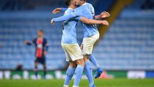 La sérénité offerte par la charnière centrale Ruben Dias - John Stones a permis à Manchester City de franchir un palier. (PAUL ELLIS / AFP)
