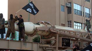 Des combattants de l'Etat islamique à Raqa (Syrie), en juin 2014. (AFP PHOTO / HO / WELAYAT RAQA)