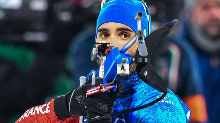 Martin Fourcade lors de l'épreuve de relais mixte de biathlon, àPyeongchang (Corée du Sud), le 20 février 2018. (FRANCOIS-XAVIER MARIT / AFP)