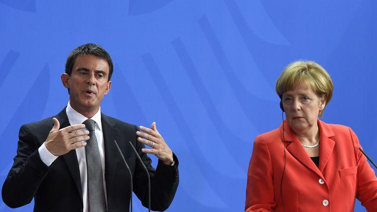 Manuel Valls et Angela Merkel face à la presse à Berlin (Allemagne), el 22 septembre 2014 (TOBIAS SCHWARZ / AFP)