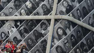 Les portraits de JR à Times Square, New York, en juin 2013  (Emmanuel Dunand / AFP)