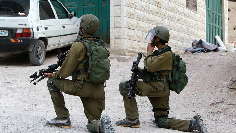 Des soldats israéliens, le 19 octobre 2015 à Bethléem (Palestine). (MUSA AL-SHAER / AFP)