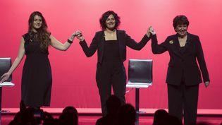 Marlène Schiappa, Myriam El Khomri et Roselyne Bachelot sur la scène du Théâtre Bobino, à Paris, le 7 mars 2018  (Thomas Samson / AFP)