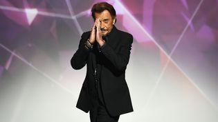 Le chanteur Johnny Hallyday, sur la scène des Victoires de la musique, le 12 février 2016, au Zenith de Paris. (BERTRAND GUAY / AFP)