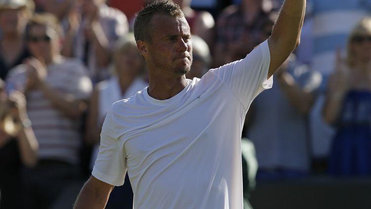 Lleyton Hewitt, après son élimination au 1er tour de Wimbledon 2015, face à Jarko Nieminen. (ADRIAN DENNIS / AFP)