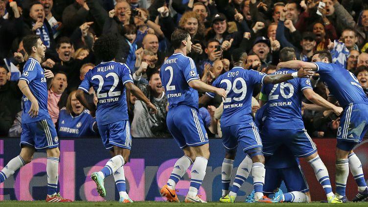 La joie des Blues après leur qualification pour les quarts de finale de la C1 (ADRIAN DENNIS / AFP)