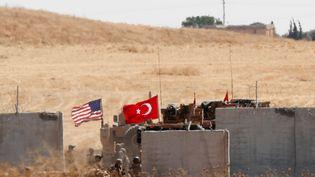 Des troupes américaines et turques à la frontière turco-syrienne, le 8 septembre 2019. (MURAD SEZER / REUTERS)