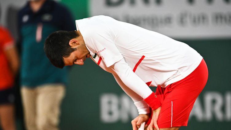 Novak Djokovic en souffrance contre Pablo Carreno-Busta. (ANNE-CHRISTINE POUJOULAT / AFP)